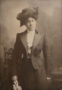 African American woman in Edwardian outfit and hat