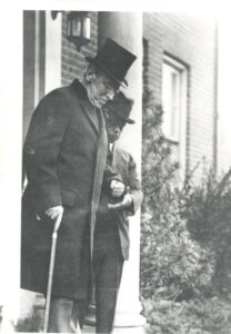 Woodrow Wilson with Isaac Scott in front of S Street home.
